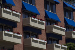 Patterned Windows. And balconies on urban structure Royalty Free Stock Images