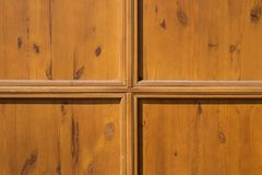 Patterned wooden door surface texture in good condition royalty free stock photos