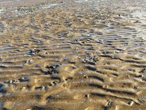 Patterns on the Beach. 3. Patterns in the sand; with textures, light and shadow Royalty Free Stock Photos