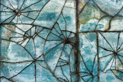 Patterns of broken glass tile on the wall. Stock Photo