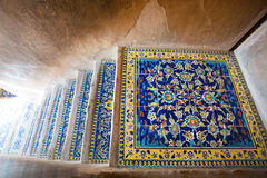Patterns of ceramic floor tile on the stairs of the historic palace. ISFAHAN, IRAN: Patterns of ceramic floor tile on the stairs of the historic palace royalty free stock photos