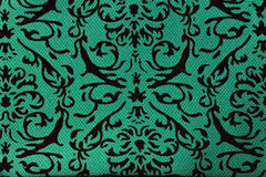 patterns on a green cloth Stock Photography