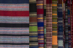 The Patterns of hand made fabric woven in the North of Thailand. Stock Photo