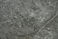 Patterns In Lake Ice. Cracks and bubble form interesting patterns in lake ice, making a good background Royalty Free Stock Images