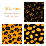 3 patterns with pumpkins. Set of vector seamless patterns with traditional carved pumpkins. Perfect backgrounds for your Halloween design Royalty Free Stock Photos