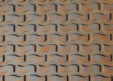 Patterns on rusty iron manhole cover Stock Photo
