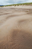 Patterns in sand at beach with copy space Stock Photos
