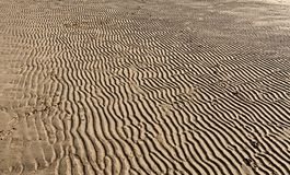 Patterns in the Sand on a Beach stock photography