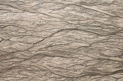 Patterns in the sand from the retreating tide Stock Photography
