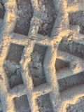 Patterns the sand. Tire tracks in beach Stock Photography