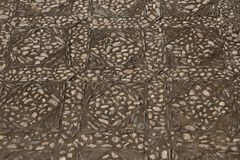Patterns on a stone walking path at the Alhambra palace in Grana. Da, Spain, Europe Royalty Free Stock Photos