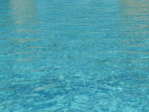 Patterns of sunlight rippling on a swimming pool Stock Image
