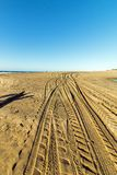 Patterns and Texture of Vehicle Tracks on Beach Sand stock photos