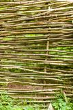 Closeup of fence made of many wooden sticks. Patterns and textures details concept. Closeup of fence made of many wooden sticks royalty free stock photo