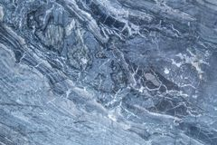Patterns and textures of natural gray and black marble walls for. Patterns and textures of natural blue and black marble walls for background and tile design Stock Image