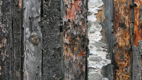 Patterns and textures of unprocessed planks. A fence made of rough planks attracts attention with its decorative qualities, textures and rough texture Stock Photography