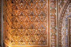 Patterns on walls inside the 14th century Alcazar royal palace in Mudejar architecture style, Seville stock images