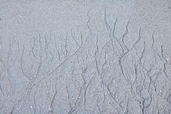 The patterns of water erosion sand on the beach. royalty free stock photos
