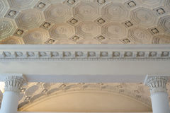 Patterns on a white ceiling molding indoors.  royalty free stock photos