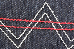 Patterns of yarn on the back of black jeans. Stock Photo