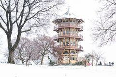 The Patterson Park Pagoda in the snow, in Baltimore, Maryland stock images