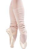 Pattes dans des chaussures de ballet 1 Photographie stock libre de droits