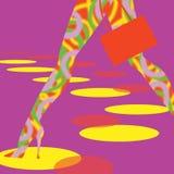 Pattes dans les bas colorés Photos libres de droits