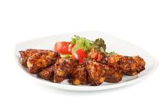 Pattes de poulet avec de la salade Photo libre de droits
