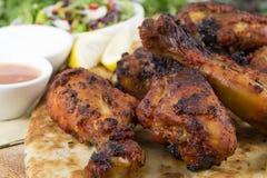 Pattes de poulet tandooris Images libres de droits