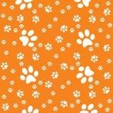 Pattes fond orange-foncé sans couture, modèle de patte illustration de vecteur