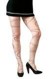 Pattes sexy de femme dans le pantyhose moderne de type images libres de droits