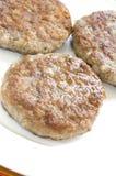 patties λουκάνικο χοιρινού κρέατος Στοκ Εικόνες