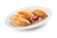 Patties with apples on white plate isolated on the white backgro Stock Photos