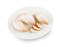 Patties with apples on white plate isolated on the white backgro Royalty Free Stock Photos