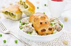 Patties with green peas for children in the form of a hippopotam Royalty Free Stock Images