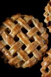 Patties with a lattice made of dough. Stuffing from strawberries, apricots, nectarines, peaches, cherries. Close-up royalty free stock image