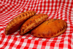 Patties on a red tablecloth Stock Photography