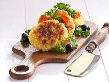 Patties of rice. On a wooden tray Royalty Free Stock Photos