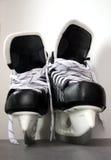 Pattini del hokey di ghiaccio Fotografie Stock