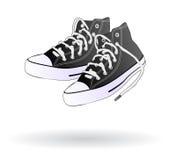 Pattini della scarpa da tennis isolati Immagine Stock