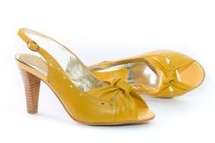Pattini della signora gialla. Fotografie Stock