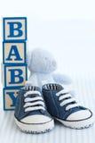 Pattini di bambino blu Fotografia Stock Libera da Diritti