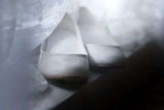 Pattini di bianco di cerimonie nuziali Immagine Stock