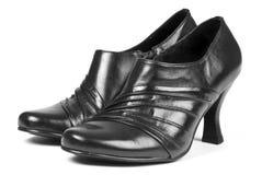 Pattini di vestito di cuoio neri delle donne immagine stock libera da diritti