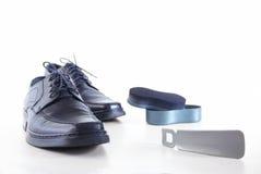 Pattini ed accessori dell'uomo per calzature Fotografia Stock Libera da Diritti