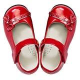 Pattini rossi del bambino su bianco Fotografie Stock Libere da Diritti
