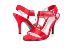 Pattini sexy e rossi dell'alto tallone su bianco Fotografie Stock