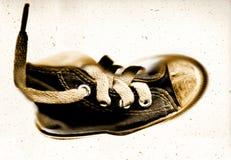 Pattino-vecchia scarpa da tennis del grunge di sport Fotografia Stock Libera da Diritti