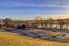 Pattullo Bridge in an early morning of winter with beautiful landscape under golden sunlight Royalty Free Stock Photos