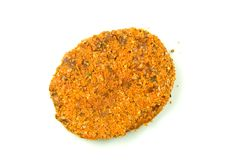 Patty. A breaded uncooked beef patty Stock Image